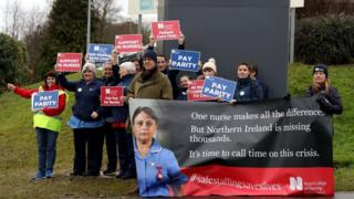 Nurses holding placards on a picket line