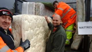 Photo of council staff collecting old mattresses