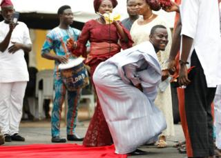A groom dances at his traditional wedding at the Ikeja marriage registry in Lagos, Nigeria, May 5, 2018.