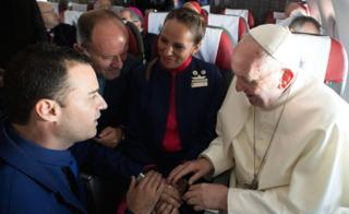 Pope Francis celebrates the marriage of crew members Paula Podest and Carlos Ciufffardi during the flight between Santiago and the northern city of Iquique, 18 January 2018