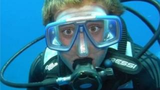Rich Osborn under water and scuba diving