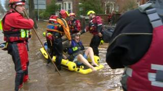 Mountain rescue volunteers help flooded residents in Cumbria