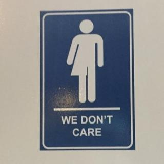 We don't care gender neutral bathroom sign