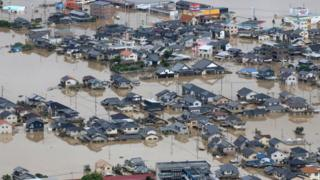 An aerial view of flooded houses in Kurashiki