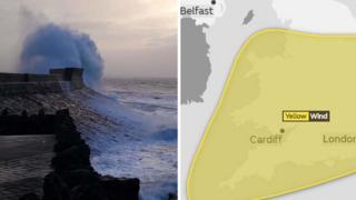 A wave hits a coastal wall in Porthcawl, Bridgend county