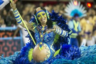 in_pictures A member of Portela samba school performs during the first night of 2020 Rio's Carnival Parades at the Sapucai Sambadrome on 23 February.
