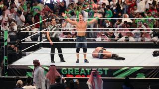 John Cena celebrates in the ring during Friday's Greatest Royal Rumble in Jeddah