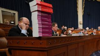 House Ways and Means Committee member Rep. Tom Reed (R-NY) keeps a stack of books that document the current federal tax code and related regulations on his desk during the first markup of the proposed GOP tax reform legislation in the Longworth House Office Building on Capitol Hill November 6, 2017 in Washington, DC.