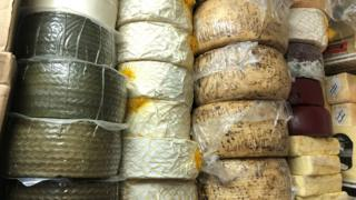 Wheels of cheese in storage