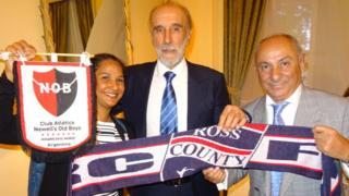 Ricky Villa and Ossie Ardiles with Ross County scarf and a fan in London on Thursday night