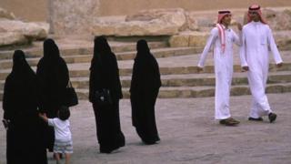 Women and men walks on the streets of Riyadh, Saudi Arabia. File photo