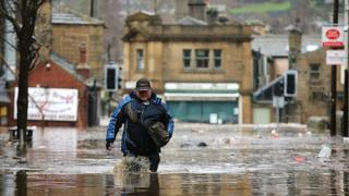 Man wades through flood water