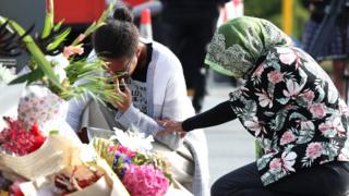 Locals lay flowers in tribute to those killed and injured at Deans Avenue near the Al Noor Mosque on March 16, 2019 in Christchurch, New Zealand