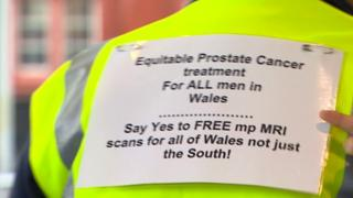 """A sign reading """"say yes to free mp MRI scans for all of Wales not just the south"""""""