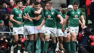 Jacob Stockdale (3rd L) of Ireland celebrates with teammates after his first try during the Ireland v Scotland Six Nations rugby championship game at Aviva Stadium on March 10, 2018 in Dublin, Ireland