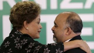 President Dilma Rousseff (L) greets Sports Minister George Hilton during a ceremony to announce measures to modernize Brazilian soccer at the Planalto Palace in Brasilia, Brazil, in this March 19, 2015 file photo.