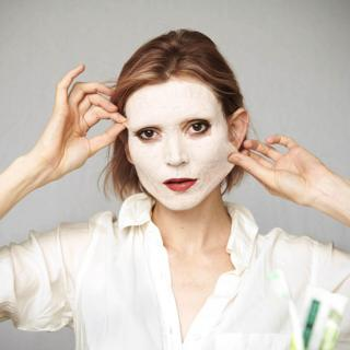 Woman with a face mask applied