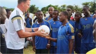 A representative of Sunderland football club with children in Tanzania