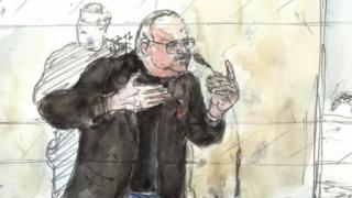 A court sketch shows Ilyich Ramirez Sanchez, known as Carlos the Jackal, gesturing during his trial in France (13 March 2017)