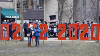 People gather on the eve of Groundhog Day in Punxsutawney, Pennsylvania