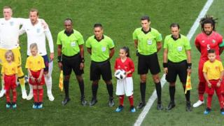 Alysia, from Huddersfield, with officials and players before the FIFA World Cup Group G match between England and Panama at the Nizhny Novgorod Stadium, Russia, on 24 June