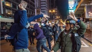n this photo taken on February 9, 2016, protesters clash with police during demostrations, later dubbed the 'Fishball Revolution', in the Mongkok area of Hong Kong.