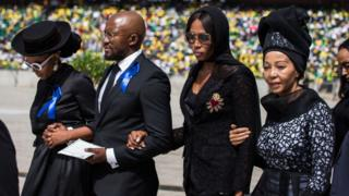 British super model Naomi Campbell walks with members of the Mandela family during the funeral of anti-apartheid icon Winnie Madikizela-Mandela at the Orlando Stadium in the township of Soweto, concluding 10 days of national mourning on April 14, 2018, in Johannesburg.