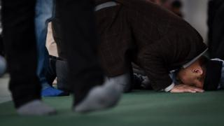 A man prays at the Baitul Futuh Mosque of Britain's Ahmadiyya Muslim community in Morden in south London
