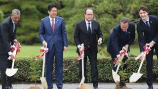 World leaders take part in a planting ceremony on the grounds at Ise-Jingu Shrine in the city of Ise in Mie prefecture, on May 26, 2016 on the first day of the G7 leaders summit.