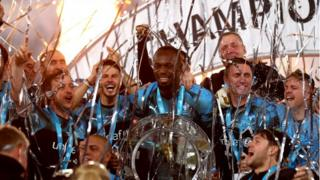 bolt-holds-soccer-aid-trophy