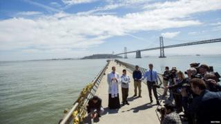 Father Cameron Faller leads a prayer vigil for shooting victim Kathryn Steinle on Pier 14 in San Francisco - 6 July 2015