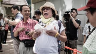 Protester wearing fake breasts in Wan Chai, Hong Kong (2 Aug 2015)
