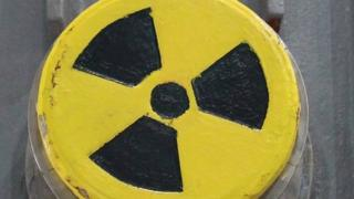 A symbol for radioactivity on a radioactively-contaminated container once used to transport nuclear fuel rods