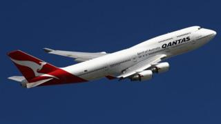 A Qantas plane in the air
