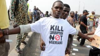 A protestor sports a an anti-corruption T-shirt on January 9, 2012 in Lagos during a demonstration against the more than doubling of petrol prices after government abolished fuel subsidies