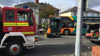A Cardiff bus and a motorbike collided in the Birchgrove area of the Welsh capital