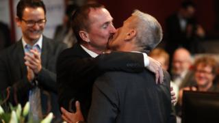 Karl Kreile (L) kisses Bodo Mende during the first civil wedding ceremony between two men in Berlin, Germany (01 October 2017)