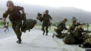 British soldiers running on duty in Kosovo in 1999