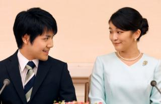 Princess Mako, the elder daughter of Prince Akishino and Princess Kiko, and her fiancee Kei Komuro, a university friend of Princess Mako, smile during a press conference to announce their engagement at Akasaka East Residence in Tokyo, Japan, September 3, 2017.