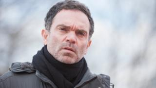 Yann Moix in outside shot
