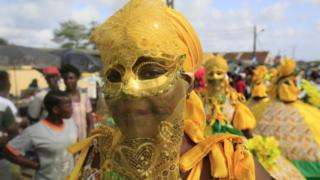 Ivorians take part in a parade on the last day of the 38th Popo Carnival in Bonoua, 60km south of Abidjan, Ivory Coast, 14 April 2018. The carnival of Bonoua is the Ivoirians version of Mardi Gras running for a week. Derived from at first a celebration of the cultural heritage of the Aboure people, the Popo Carnival involves gastronomic competitions, Miss pageants, sports days, a festival of traditional dances and reflection workshops on Popo museum amongst other activities.