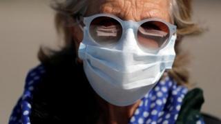 Israeli woman wears mask in Haifa