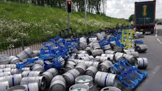 Beer kegs on the road, having falling from a lorry on the A43 near Towcester.