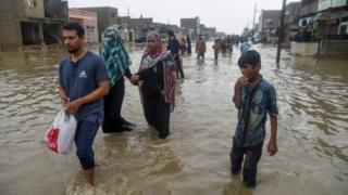 People in flooded water
