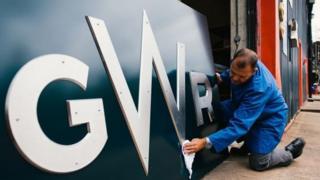 Man polishing GWR train