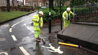 Puddle outside Drummond Central in Jesmond, Newcastle being drained