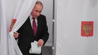 Vladimir Putin votes in Moscow, Russia, on 18 March 2018
