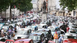 Taxis blockade Whitehall in protest at Uber in June 2014