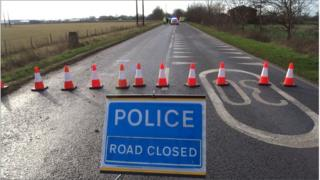 The emergency services were called to the village of Yaxley, near Peterborough, at about 11:12 GMT on Tuesday.