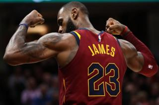 LeBron James of the Cleveland Cavaliers shows off his biceps after scoring a basket